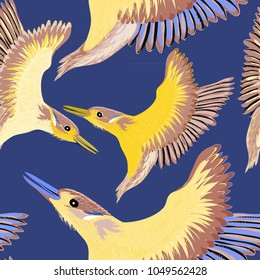 Yellow birds with purple and brown wings. Seamless pattern. Vector illustration of the yellow birds on blue background