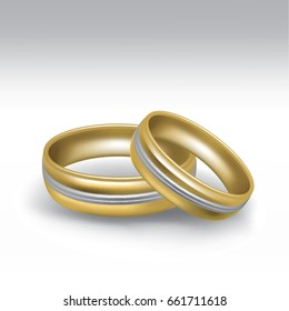 Yellow gold wedding rings in pair with white gold ornament - isolated on white background