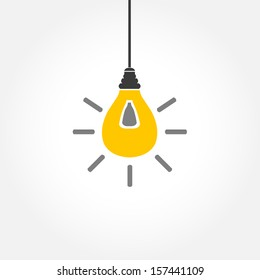 Yellow hanging light bulb on white background