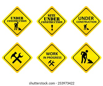 Yellow on black graphics signs or icons indicating a website is under constructions or in development. isolated on white background