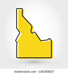 yellow outline map of Idaho, stylized concept