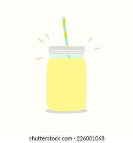 Yellow smoothie in jar