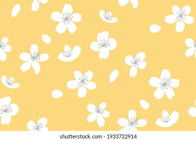 Yellow spring background with white tree blossom. Apple and peach flowers, falling petals. Asian sunny seamless texture. Vector japanese repeat