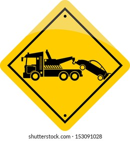 yellow tow road sign