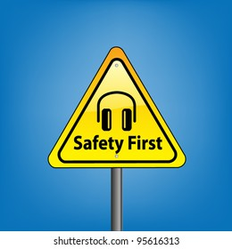 Yellow triangle hazard warning sign against blue sky - safety first ear protection symbol indication, vector version