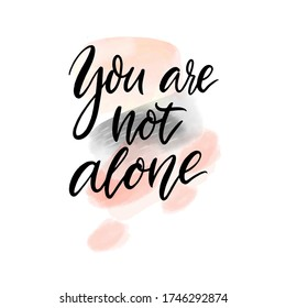 You are not alone. Support quote. Inspirational saying, handwritten calligraphy text on abstract pink and gray watercolour stains