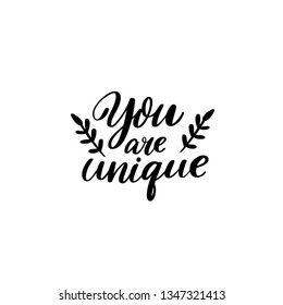 You are unique. Modern caligraphy inscription for greeting cards and apparel. Inscpirational quote design.