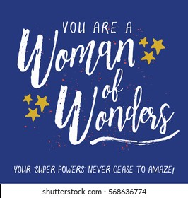 You are a Woman of Wonders. Your Super Powers never cease to amaze! Brush Script Typography Design Art poster with white letters, gold stars, and gold ink splatter on blue background.