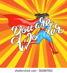 You are Wonder - hand lettering. Runing Woman. Female Hero. Girl in Superhero Costume. Pin Up Comic Style. Pop art vector illustration