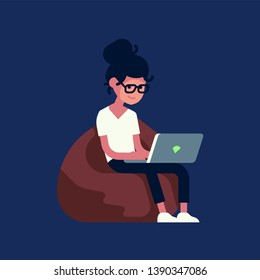 Young adult person sitting on bean bag working on laptop computer. Flat style vector illustration on cheerful genderqueer character uses mobile device in the dark