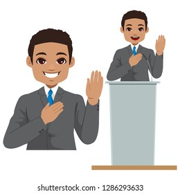 Young African American politician making oath with hand