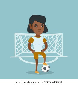 Young african-american sportswoman standing with a football ball on the background of football gate. Football player standing with a ball on the field. Vector cartoon illustration. Square layout.