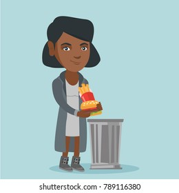 Young african-american woman putting junk food into a trash can. Smiling woman throwing out unhealthy junk food. Concept of healthy lifestyle and nutrition. Vector cartoon illustration. Square layout.