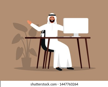 Young Arab man sitting at the table using the computer. Happy Muslim employee wearing white clothes working at home or office. Color vector illustration in flat cartoon style.