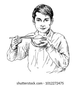 Young asian man eating rice with chopsticks.