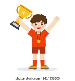Young athletes boy won the football match. A boy holding winner cup, kid celebrating his victory.