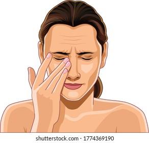 Young attractive, beautiful woman rubbing her eye, eye massage, eye care