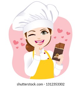 Young beautiful chef woman holding bitten chocolate bar temptation concept