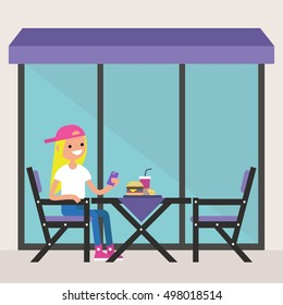 Young blonde girl sitting on the restaurant terrace under the awning and making a photo of her dinner / editable flat vector illustration