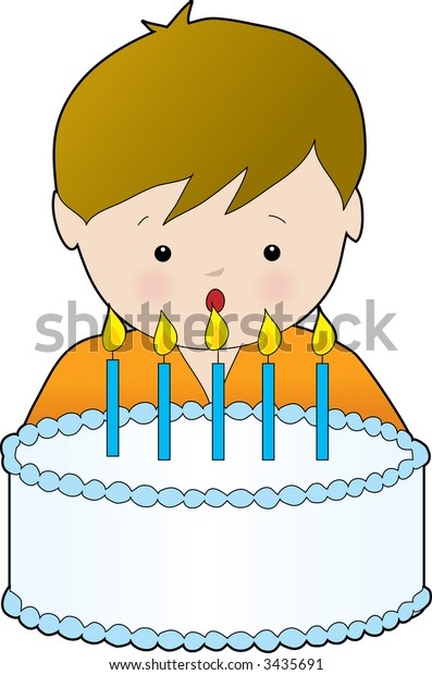 Young boy blowing out the candles on his birthday cake