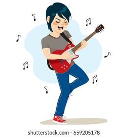 Young boy playing electric guitar rock music
