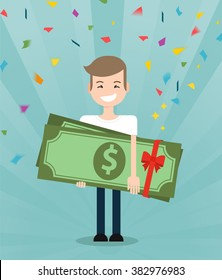 Young brunette guy really happy enjoying and holding huge gift pack of green money/dollars with both hands. Win in a lottery concept