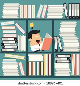 Young businessman having a idea while reading a book, Business idea