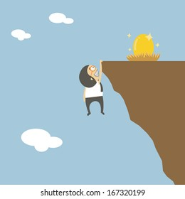 Young businessman scaling a rock to reach a large gold egg