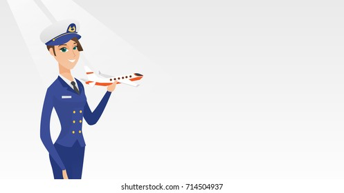 Young caucasian airline pilot holding the model of airplane in hand. Cheerful female airline pilot in uniform. Smiling pilot with the model of airplane. Vector cartoon illustration. Horizontal layout.