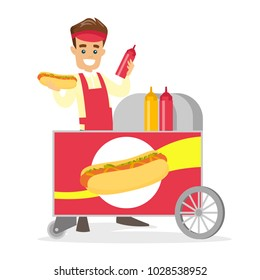 Young caucasian white street seller dressed in an apron standing with hot dog cart. Small business and street food concept. Vector cartoon illustration isolated on white background. Square layout.