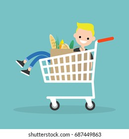 Young character fooling around in the supermarket. Riding in the cart / flat editable vector illustration, clip art
