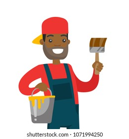Young cheerful african-american house painter holding a paintbrush and bucket with yellow paint. Concept of house renovation and construction. Vector cartoon illustration isolated on white background.