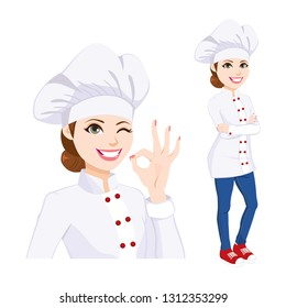 Young confident chef woman standing in uniform winking one eye and gesturing ok hand sign