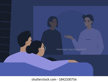 A young couple cuddling and watching a movie on a video projector, a lockdown leisure