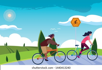 young couple riding bike in landscape with signage for cyclist
