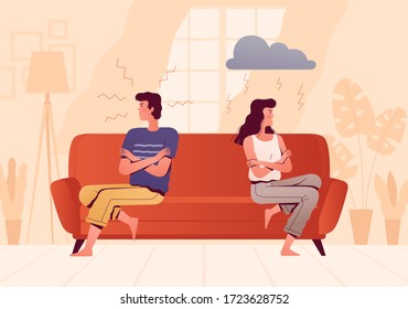 A young couple sits on opposite sides of the couch and quarrels. People spend time at home. The psychological concept of family quarrel and misunderstanding. Home conflict