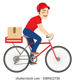 Young delivery service man on bicycle delivering cardboard package