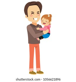 Young father holding cute cheerful daughter with happy face expression