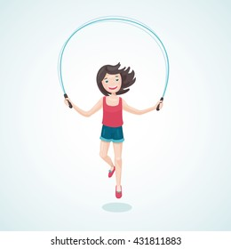 Young girl is jumping with a jump rope.