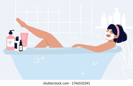 Young girl laying in bathtub with face mask doing hygiene and self care and enjoying her beauty ritual. Woman bathroom with cosmetics around: cream, mask, serum dropper bottle, hair spray and shower.
