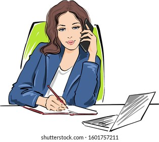 A young girl is sitting in a blue business suit at a table with a computer. She writes with a pen in a notebook at the same time and talks on the phone.