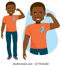 Young happy black male with blue ribbon standing prostate cancer support concept and orange shirt