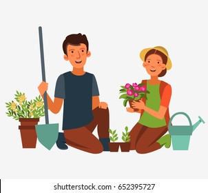Young, happy couple gardening. Smiling man and woman work in garden and planting flowers. Family fun in summer