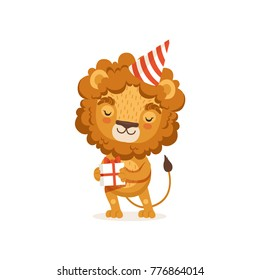 Young lion cartoon character wearing party hat and holding gift box. African animal with lush mane and cute tail. Flat vector isolated on white.