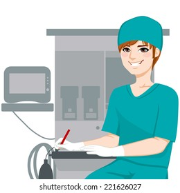 Young male nurse working writing documents in front of anesthetist medical equipment machine