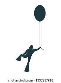 The young man in diver suit flying with toy balloon