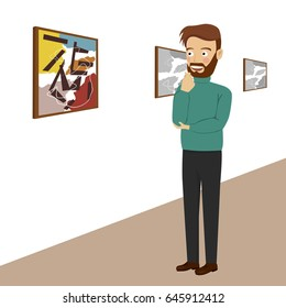 Young man in gallery room looking at abstract paintings