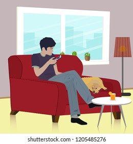 The young man and his dog sit on the couch in the living room