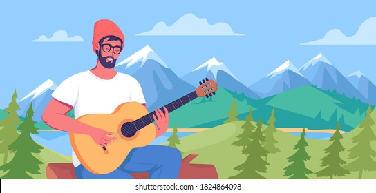 Young man playing guitar on nature background