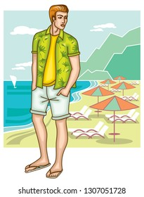 Young man in shorts is standing on the beach.